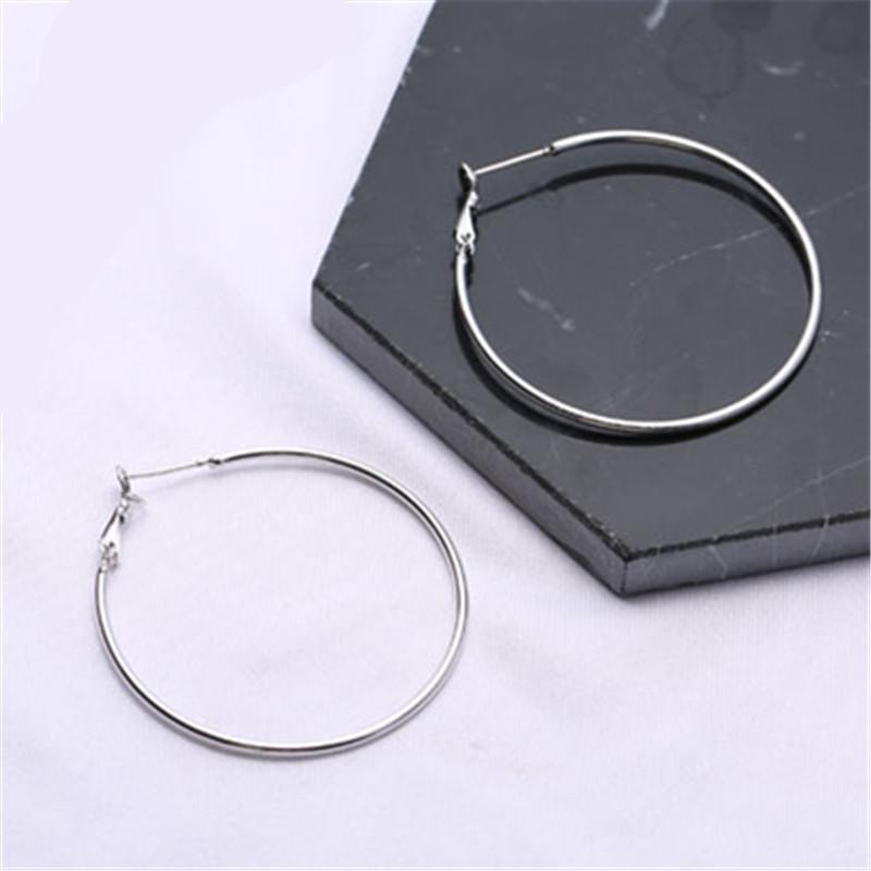 Goldfarben-runde Kreis-Tropfen-Ohrringe für Frauen glänzend glatt Klar übersichtliches Design Charm Ohrringe baumeln Modeschmucksachen A305