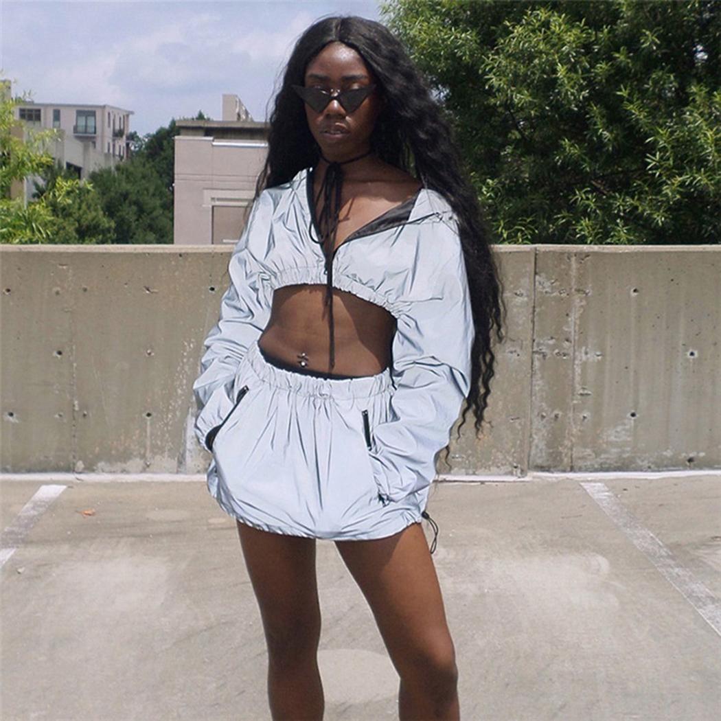 Moda Nuevas Mujeres Moda Sólido Reflectante Con Capucha de Manga Larga Crop Top Mini Falda Nueva Moda Ropa de mujer