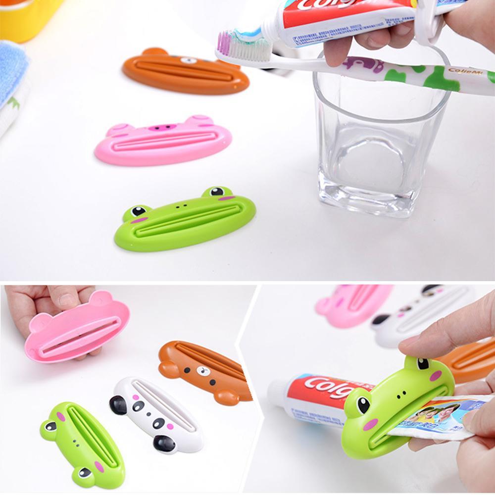 4*Plastic Bathroom Home Tube Rolling Holder Squeezer Easy Toothpaste Dispenser//